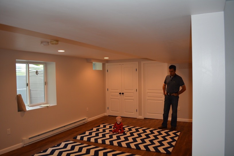 Boxford Ma. Basement Living room showing egress window installed and closets.