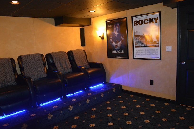 Bridgewater Movie Room In Basement With Elavated Seating.